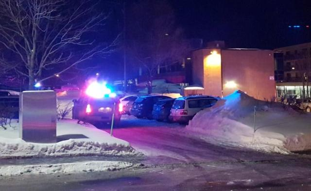 Police arrive at the scene of a fatal shooting at the Quebec Islamic Cultural Centre in Quebec City, Canada, January 29, 2017. REUTERS/Mathieu Belanger