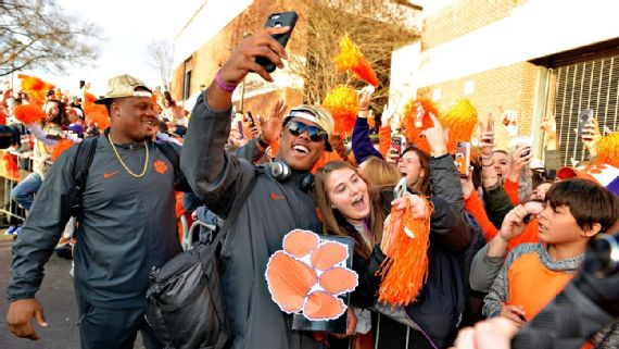 Clemson players pose with fans after returning Tuesday to South Carolina. The Tigers' official parade is set for Saturday, with the team marching from downtown to Memorial Stadium. AP Photo/Richard Shiro