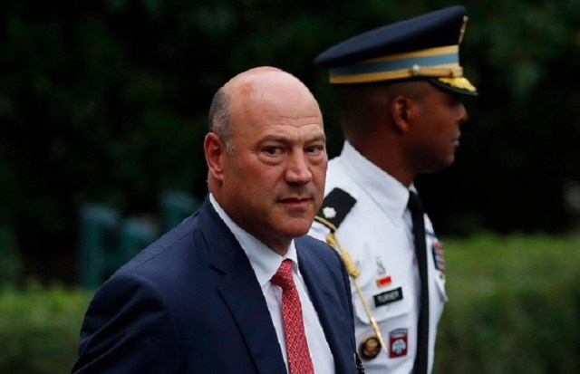The National Economic Council director Gary Cohn walking to Marine One across the South Lawn of the White House on August 14 for the short trip to Andrews Air Force Base en route to New York with President Donald Trump. (AP Photo/Carolyn Kaster)