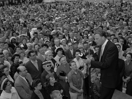 Evangelist Billy Graham at a crusade in 1959, two years after his marathon crusade in New York made him the nation's foremost evangelist. (Photo: Ernest K. Bennett, AP)