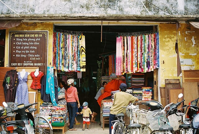 cloth market #2 by twinleaves, on Flickr - The Darker Side of Hoi An Tailors