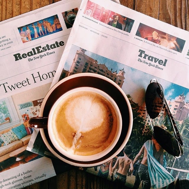 The Travel Section of the New York Times and a Cappuccino - Treat Everyday as a Vacation When You Travel and Work Full Time