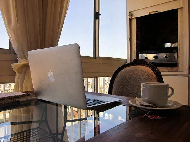 Laptop and a Cup of Tea in a Hotel Room - What Should I Major in for a Life of Travel