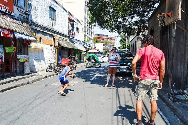 Playing Basket Ball With a Kid in Manila - Should You Visit Manila?