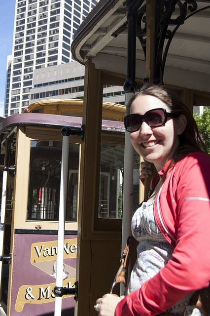Smiling on the Van Ness and Market Cable Car in San Francisco - How to Joyfully Travel with a Chronic Illness