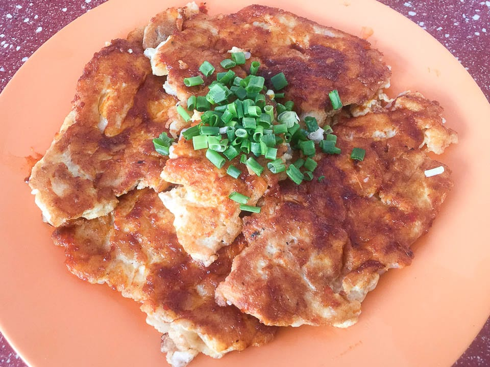 One of the Hawker foods in Singapore you should order is Carrot Cakes