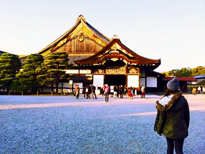 A Girl in Front of a Temple - How to Travel With Chronic Depression