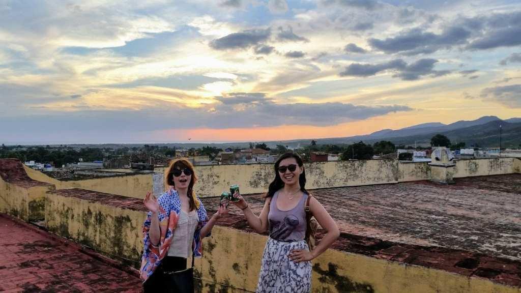 Cheersing beers on a rooftop in Cuba - A Week in Cuba