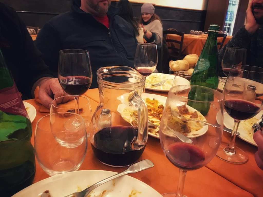 The Aftermath of Lunch with Delicious Bologna - Empty Pasta Dishes and a Liter of Red Wine