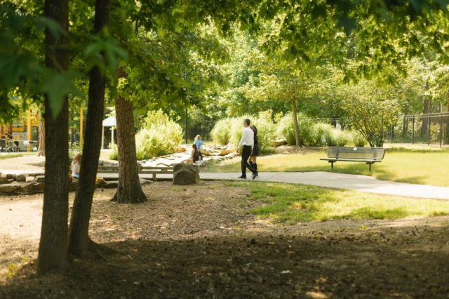 Mehran Mossaddad and his daughter walk through a park