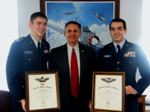 Cadet Lieutenant Colonel Michael Ebert with his Ira Eaker Award,Wisconsin's Secretary Mike Huebsch and Cadet Captain John Brennan with his Amelia Earhart Award.