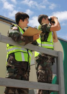 Photo by Capt. Jeri Gonwa - Cadet Second Lieutenants Tikvah Kulp and her cousin, Anthony Kulp of the Stevens Point Composite Squadron, keep track tail numbers of all incoming planes at the Appleton Base.