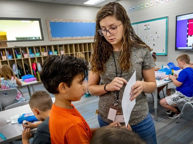 Second-grade teacher Kora Snavely works with students on an English project at Meadowlark Elementary in Andover on Aug. 17, 2021.