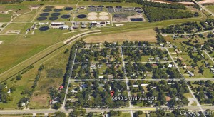 Location of one of the houses recommended for demolition. The city's primary wastewater treatment plant is in the background.