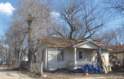 Instead of being a problem, houses like these can present economic opportunity, says John Todd.
