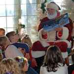 Santa reading story to kids at Old Cowtown Museum in Wichita