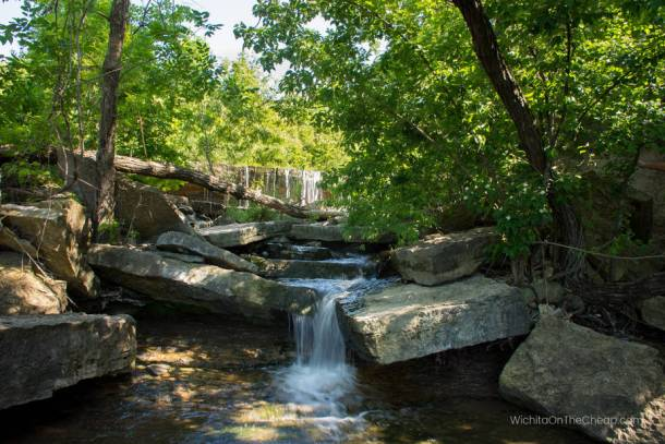 water flows down several levels of rock at chase county waterfalls in kansas