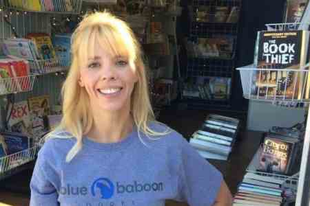 Sara Ornelas standing outside Blue Baboon Bookmobile in Wichita KS