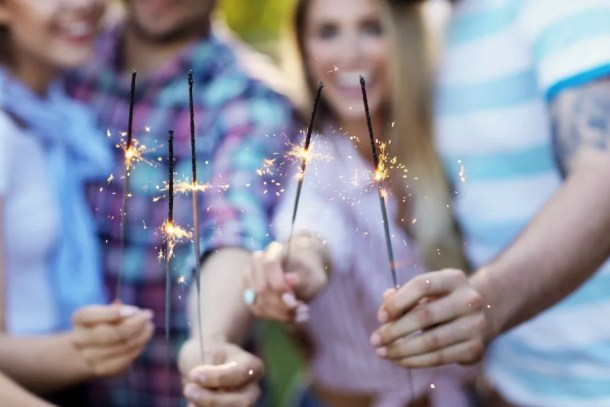 sparklers and smiling adults