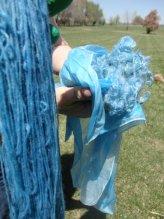 Wool yarn, silk fabric and unspun fiber
