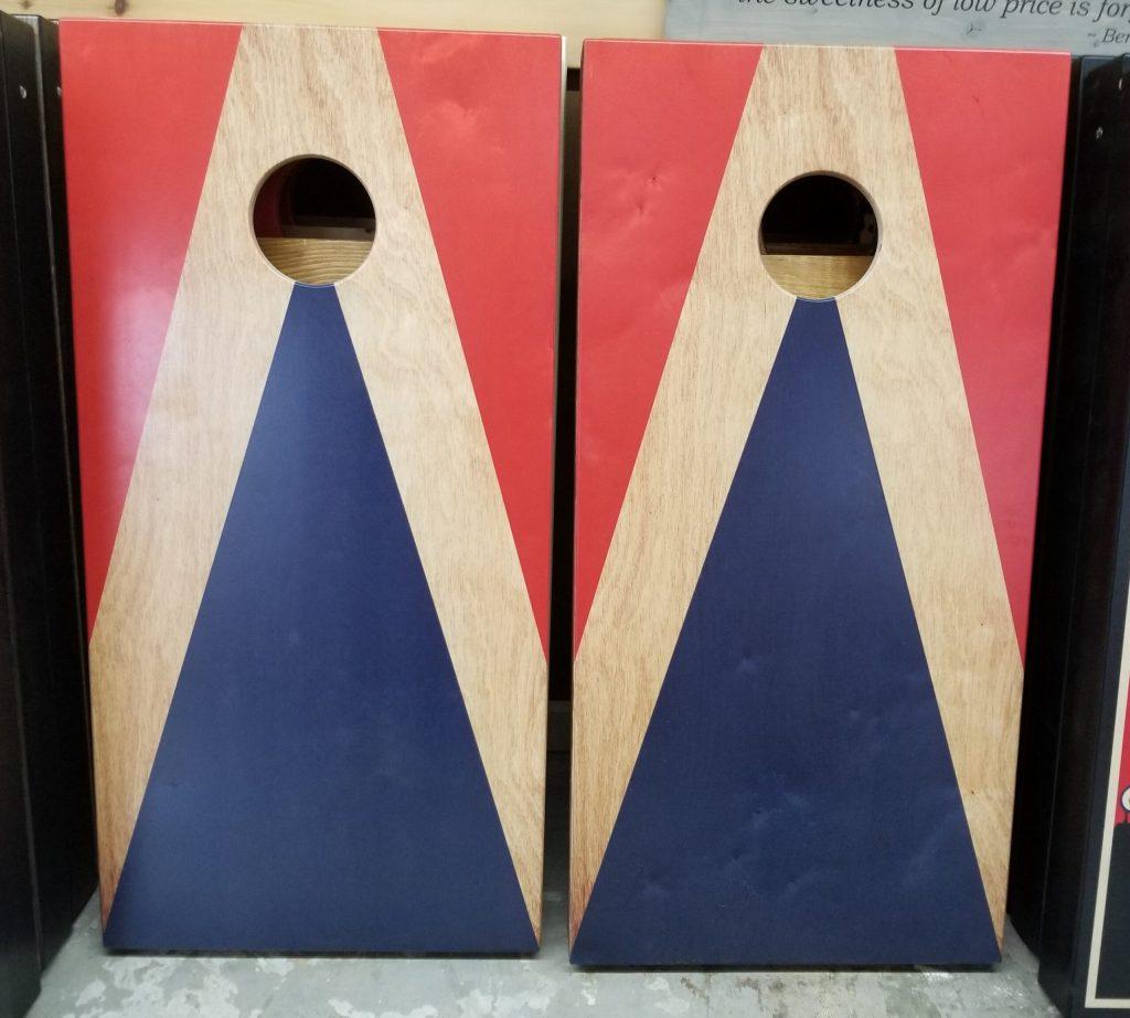 Classic high triangle red/blue cornhole board set.