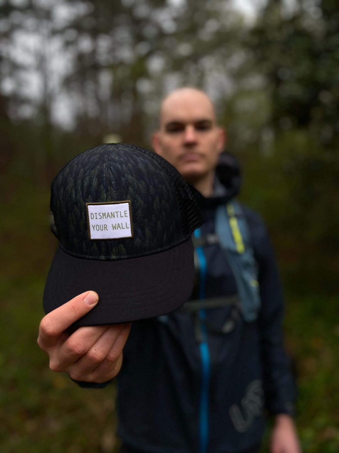 'Dismantle Your Wall' trail / ultra running performance trucker hat