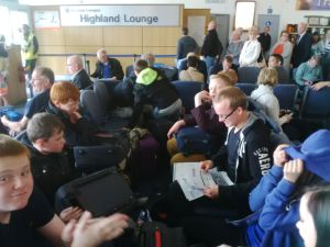 Our team wait in Inverness Airport earlier today for their flight to London
