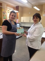 Winner Ellie Robinson receiving her prize from judge Alison Mackay