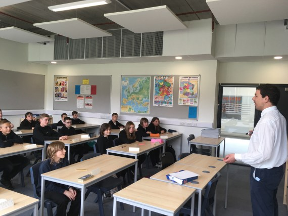 Mr Lewis delivers a French lesson to his class