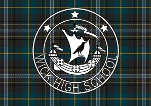 Our school badge proudly displayed on our new tartan