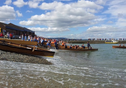 Boats reach the beach during Wicklow Regatta at Wicklow Rowing Club