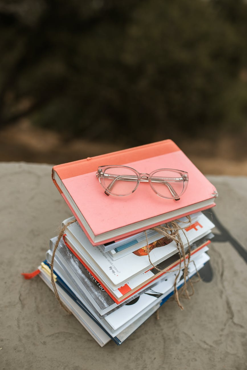 eyeglasses on stack of books