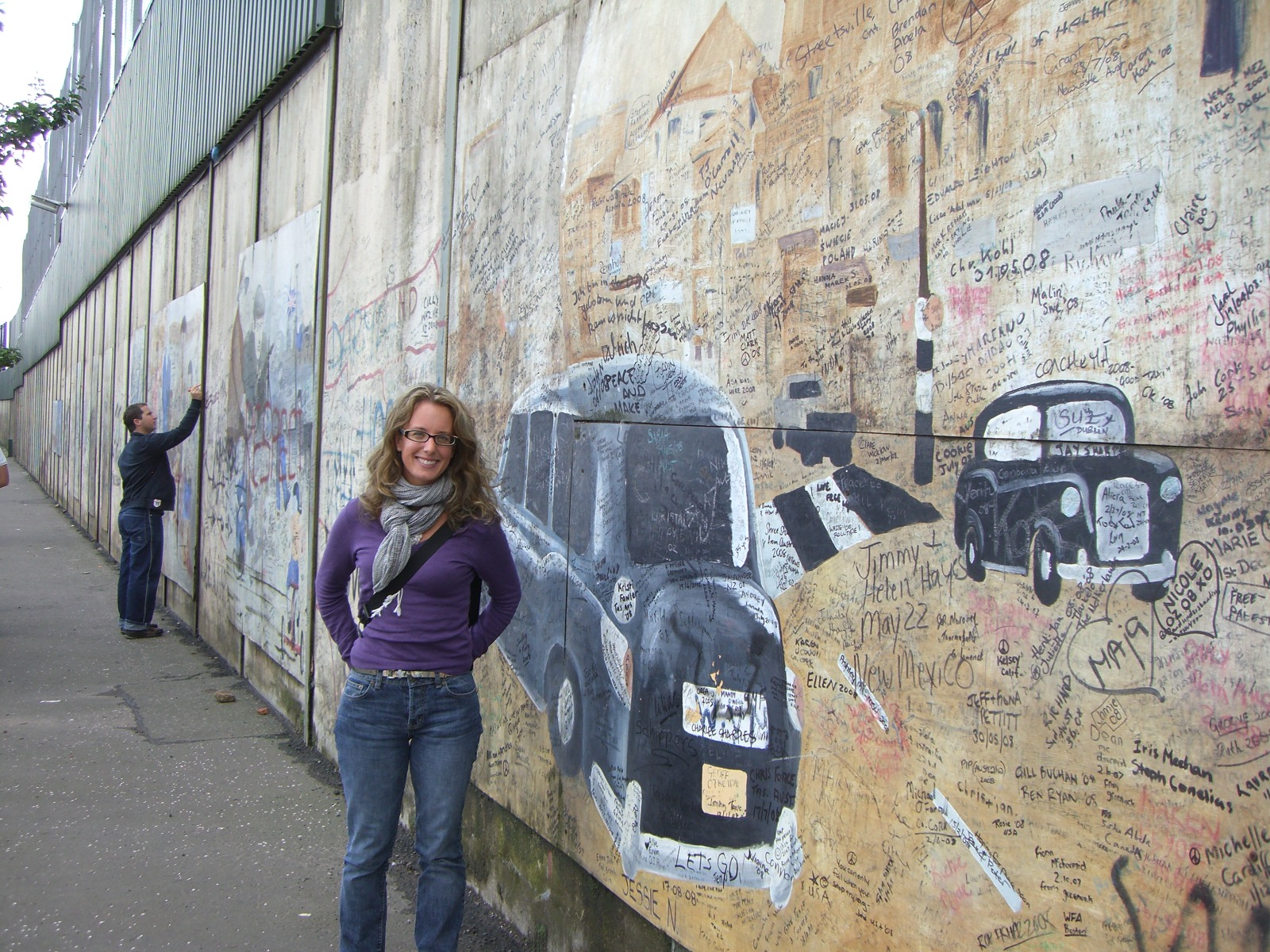By the Peace Wall (three stories high, and built to keep the Protestants and Catholics separate) in Belfast, Ireland