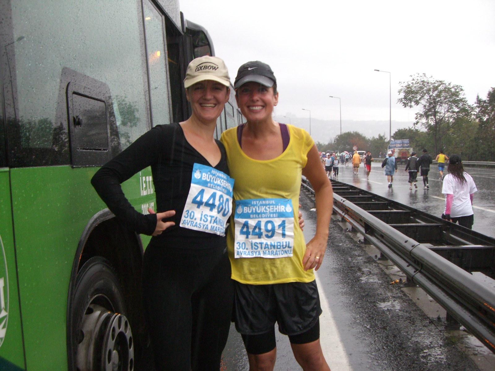 Before the race with my running partner. You can see that I am already DRENCHED.
