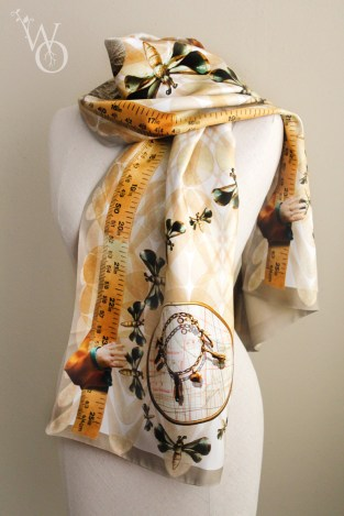 a scarf with a photorealistic print made with objects of a deceased loved one.