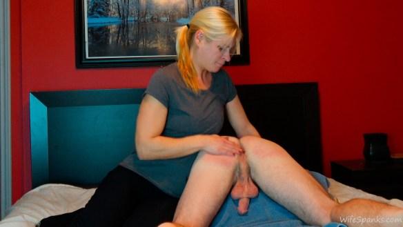 spanked over one leg