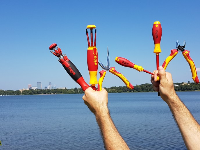 Wiha Multi-Tools in hands over lake Calhoun on Insulated Tools Tour