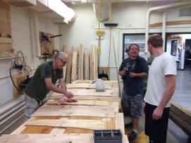 Flattening the birchbark in the wood shop. (Photo Credit: Tim Frandy)