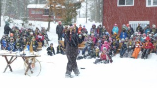 Wayne addresses school children on a snowy winter day at the Ojibwe Winter Games, Feb 2013. (Photo credit - Colin Connors)