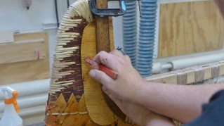 A birchbark spacer is fitted into place. (Photo credit: Colin Connors)