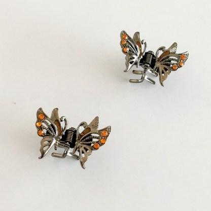 Krásny luxusný štipec do vlasov v tvare motýľa s krištáľmi. Farba- zlatá. Rozmer: 3cm