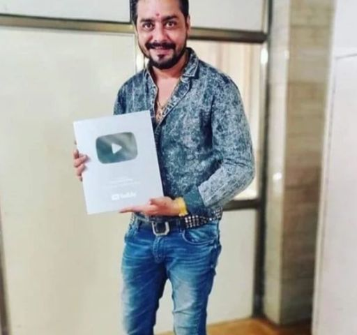 Hindustani Bhau showing his YouTube Silver Play Botton