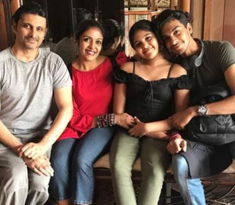 Sandhya Manoj with her husband and children