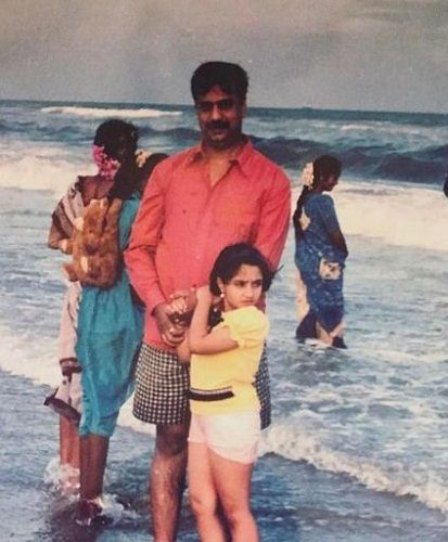 A childhood picture of Vaishnavi Gowda with his father