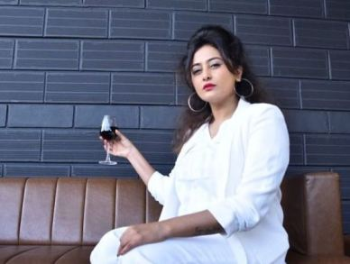Nidhi Subbaiah with a glass of wine