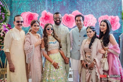 (R-L) Param Bir Singh, Savita Singh, Rupali, Rohan, Sagar Meghe (Rohan's father-in-law), and others at Rohan's wedding function