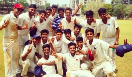 Jay Dudhane with his school cricket team