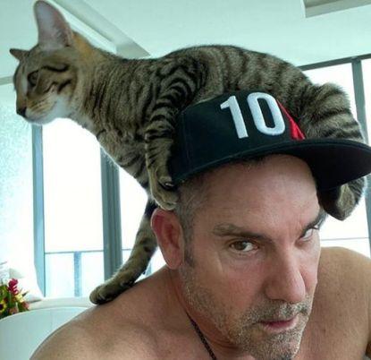 Grant Cardone with his pet cat