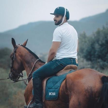 Rahim Pardesi riding a horse
