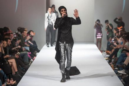 Humble the Poet walking on the ramp